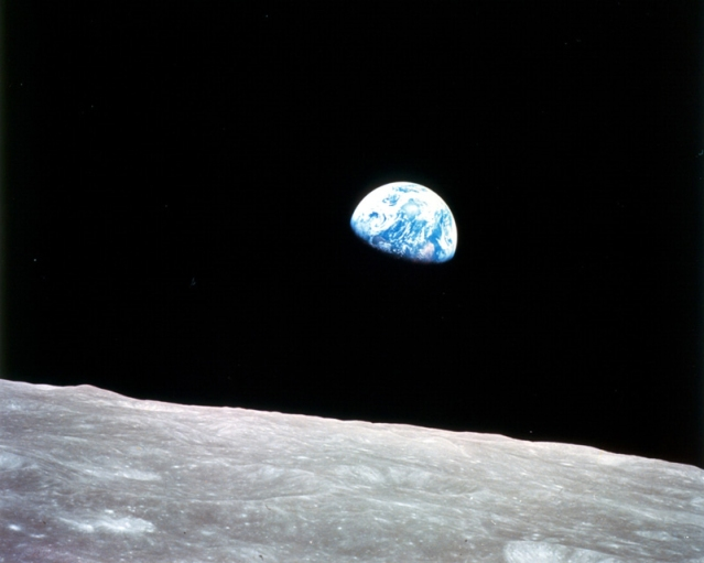 "Earthrise at Christmas Thirty-five years ago this Christmas, a turbulent world looked to the heavens for a unique view of our home planet. This photo of ""Earthrise"" over the lunar horizon was taken by the Apollo 8 crew in December 1968, showing Earth for the first time as it appears from deep space.  Astronauts Frank Borman, Jim Lovell and William Anders had become the first humans to leave Earth orbit, entering lunar orbit on Christmas Eve. In a historic live broadcast that night, the crew took turns reading from the Book of Genesis, closing with a holiday wish from Commander Borman: ""We close with good night, good luck, a Merry Christmas, and God bless all of you -- all of you on the good Earth."""