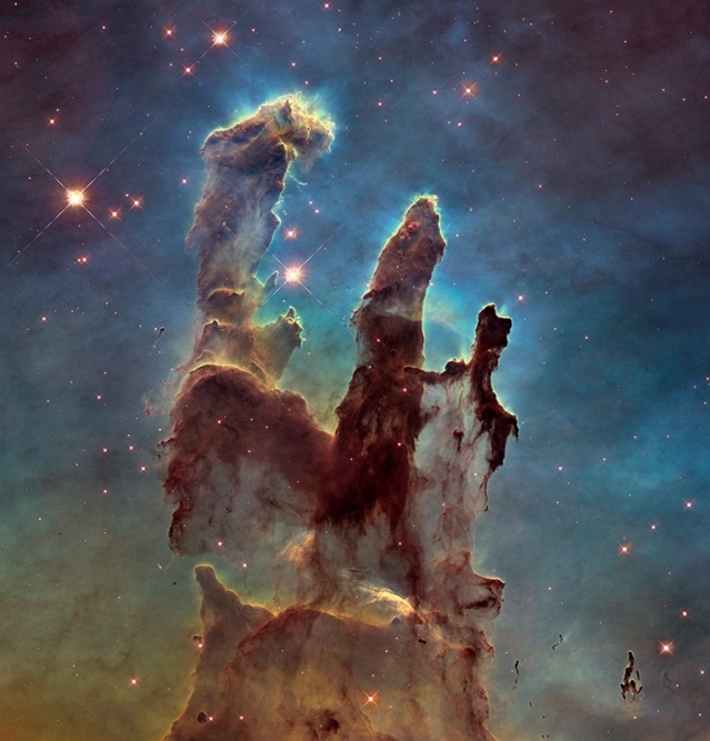 NASA's Hubble Space Telescope has revisited the famous Pillars of Creation, revealing a sharper and wider view of the structures in this visible-light image. Astronomers combined several Hubble exposures to assemble the wider view. The towering pillars are about 5 light-years tall. The dark, finger-like feature at bottom right may be a smaller version of the giant pillars. The new image was taken with Hubble's versatile and sharp-eyed Wide Field Camera 3. NASA/ESA/The Hubble Heritage Team (STScI/AURA)