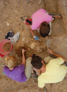 Field School students excavate human remains buried in the post-medieval churchyard at Badia Pozzeveri
