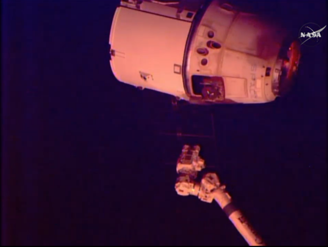 "The SpaceX Dragon cargo spacecraft was released from the International Space Station's robotic arm at 7:04 a.m. EDT Thursday. The capsule then performed a series of departure burns and maneuvers to move beyond the 656-foot (200-meter) ""keep out sphere"" around the station and begin its return trip to Earth. Credits: NASA TV"