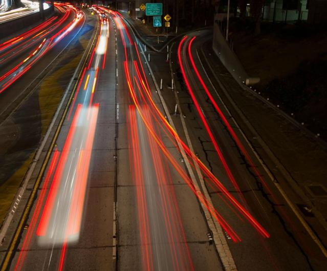 This four-second time-lapse photo of a Los Angeles freeway illustrates the complexities of decision-making, as one driver appears to have made a late change of mind while most drivers decided in advance whether to stay on the main road or take an exit ramp. Credit: Susanica Tam