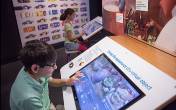 Kids use Pixar's Ratatouille interactive display at the Museum of Science. Credit: (c) Michael Malyszko
