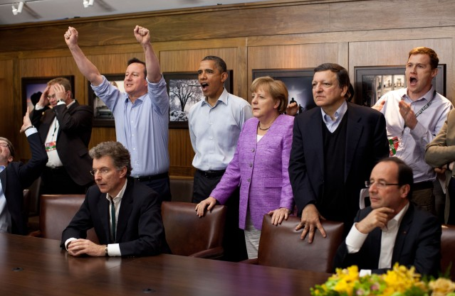 Prime Minister David Cameron of the United Kingdom, President Barack Obama, Chancellor Angela Merkel of Germany, JosŽ Manuel Barroso, President of the European Commission, and others watch the overtime shootout of the Chelsea vs. Bayern Munich Champions League final in the Laurel Cabin conference room during the G8 Summit at Camp David, Md., May 19, 2012. (Official White House Photo by Pete Souza) This official White House photograph is being made available only for publication by news organizations and/or for personal use printing by the subject(s) of the photograph. The photograph may not be manipulated in any way and may not be used in commercial or political materials, advertisements, emails, products, promotions that in any way suggests approval or endorsement of the President, the First Family, or the White House.