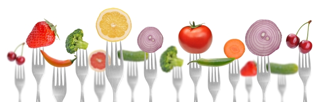 diet concept .vegetables and fruits on the collection of forks