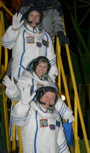 Expedition 50 crewmembers ESA astronaut Thomas Pesquet, top, NASA astronaut Peggy Whitson, middle, and Russian cosmonaut Oleg Novitskiy of Roscosmos wave farewell before boarding their Soyuz MS-03 spacecraft for launch Thursday, Nov. 17, 2016, (Kazakh Time) in Baikonur, Kazakhstan. The trio will launch from the Baikonur Cosmodrome in Kazakhstan the morning of November 18 (Kazakh time.) All three will spend approximately six months on the orbital complex. Photo Credit: (NASA/Bill Ingalls)